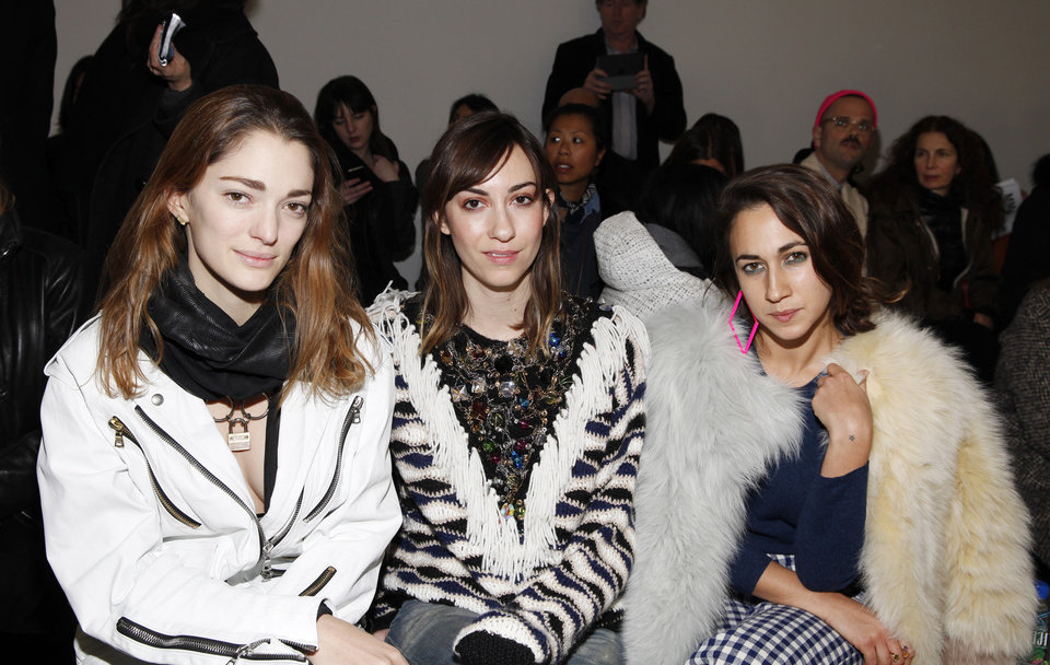 Photo - Sophia Sanchez, from left, Gia Coppola and Delfina Delettrez Fendi attend the Rodarte 2014 Fall/Winter Collection during Mercedes Benz Fashion Week on Tuesday, Feb. 11, 2014, in New York. (Photo by Amy Sussman/Invision/AP)