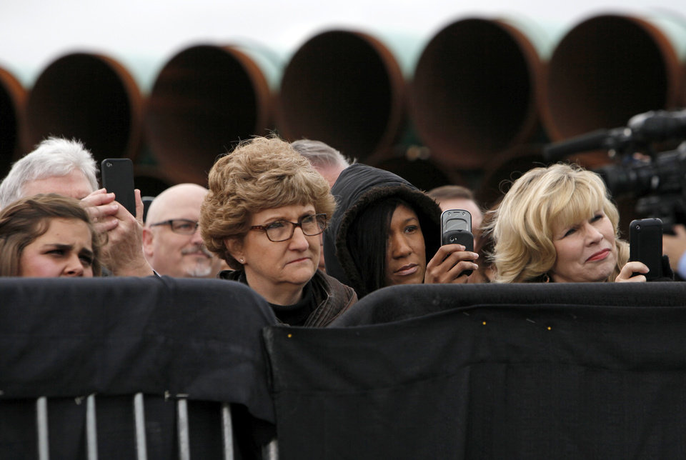 Photo - People listen to President Barack Obama speak about energy at the TransCanada Pipe Yard near Cushing, Okla., Thursday, March 22, 2012. Photo by Nate Billings, The Oklahoman