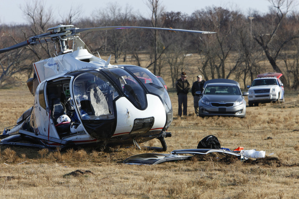 Photo - A Mediflight helicopter crash near Seminole injured four people Wednesday.  Photos By David McDaniel, The Oklahoman