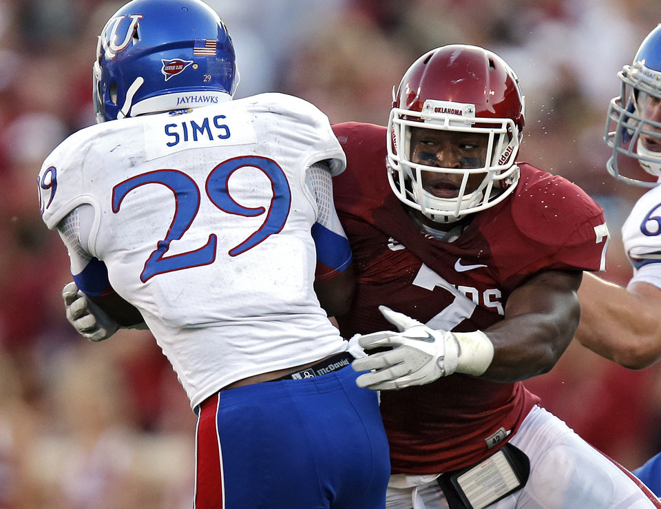 OU\'s Corey Nelson (7) brings down KU\'s James Sims (29) during the college football game between the University of Oklahoma Sooners (OU) and the University of Kansas Jayhawks (KU) at Gaylord Family-Oklahoma Memorial Stadium on Saturday, Oct. 20th, 2012, in Norman, Okla. Photo by Chris Landsberger, The Oklahoman