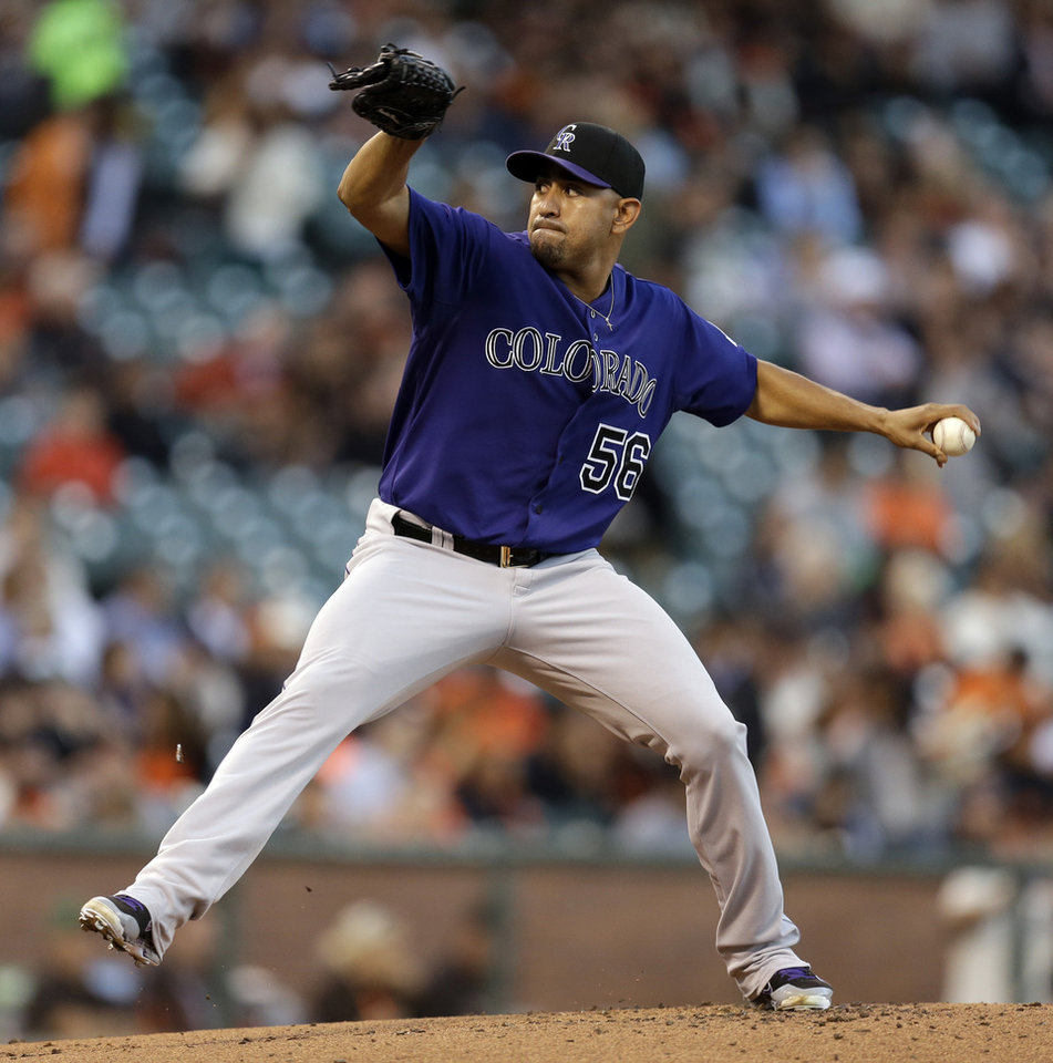 Photo - Colorado Rockies' Franklin Morales works against the San Francisco Giants in the first inning of a baseball game Wednesday, Aug. 27, 2014, in San Francisco. (AP Photo/Ben Margot)