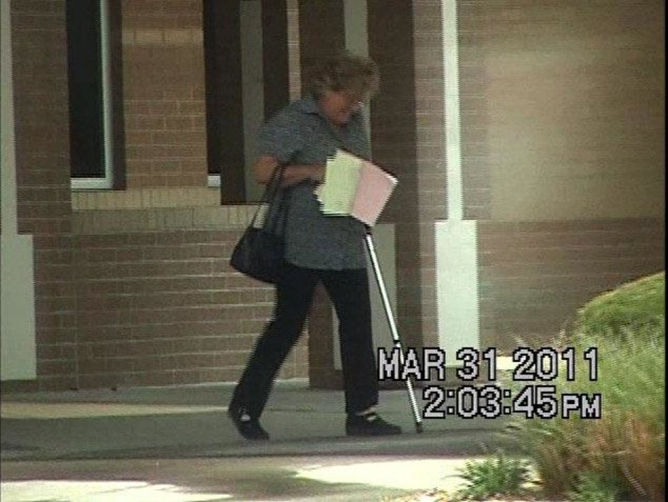 In these screen grabs from a private investigator's 2011 video, Linda Lorrie Almy, right, is shown leaving a Tulsa doctor's office with a cane, but then never using it the rest of the day. She is seen the same day walking into a casino, loading ice into her vehicle, fishing and building a bonfire by a creek.