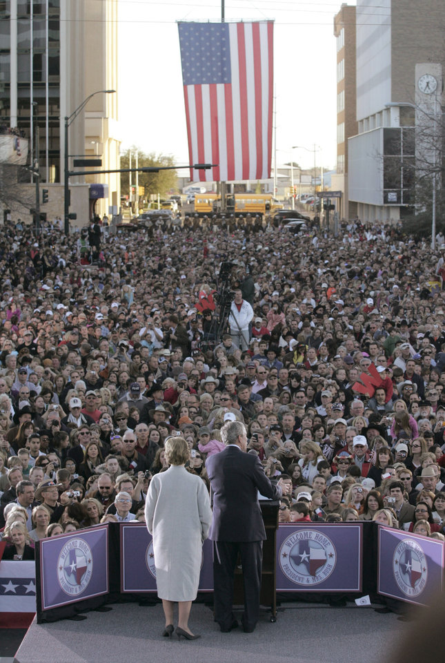 Photo - Above: Former President George W. Bush, with wife Laura, speaks Tuesday in Midland, Texas. AP PHOTO