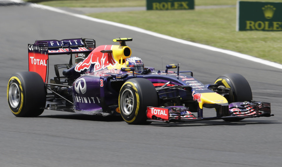 Photo - Red Bull driver Daniel Ricciardo of Australia steers his car during the qualifying of the Hungarian Formula One Grand Prix in Budapest, Hungary, Saturday, July 26, 2014. The Hungarian Grand Prix will be held on Sunday, July 27, 2014. (AP Photo/Petr David Josek)
