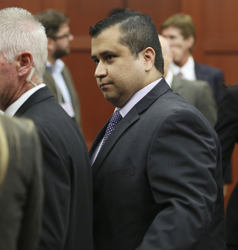 George Zimmerman leaves court with his family after Zimmerman\'s not guilty verdict was read in Seminole Circuit Court in Sanford, Fla. on Saturday, July 13, 2013. Jurors found Zimmerman not guilty of second-degree murder in the fatal shooting of 17-year-old Trayvon Martin in Sanford, Fla. (AP Photo/Gary W. Green, Pool) ORG XMIT: FLJR407
