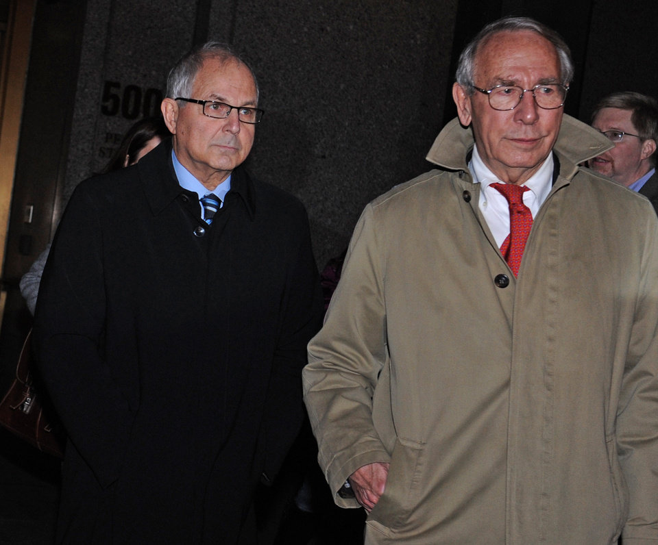 Photo - Peter Madoff, left, and his attorney John Wing exit Manhattan federal court after receiving a his sentence, Thursday, Dec. 20, 2012, in New York. The brother of imprisoned financier Bernard Madoff was sentenced Thursday to 10 years in prison for crimes committed in the shadow of his notorious sibling by a judge who said she disbelieved his claims that he did not know about the epic fraud. (AP Photo/Louis Lanzano)