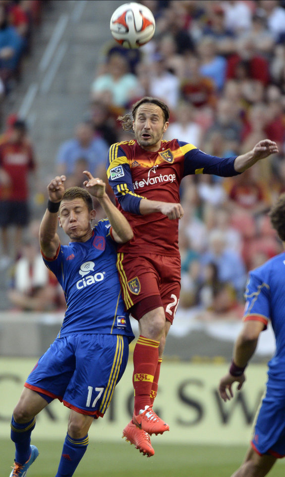 Photo - Real Salt Lake midfielder Ned Grabavoy (20) collides with Colorado Rapids midfielder Dillon Serna (17) during an MLS soccer game Saturday, May 17, 2014, in Sandy, Utah. (AP Photo/The Salt Lake Tribune, Rick Egan)  LOCAL TV OUT  MAGS OUT  DESERET NEWS OUT