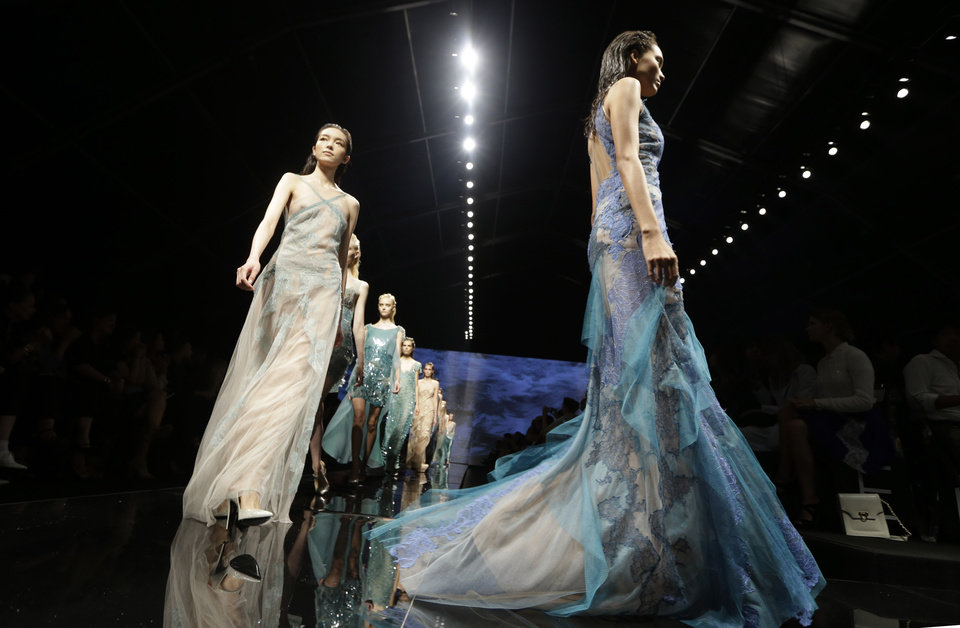 Photo -   Models wear creations part of the Alberta Ferretti women's Spring-Summer 2013 collection that was presented in Milan, Italy, Wednesday, Sept. 19, 2012. (AP Photo/Luca Bruno)