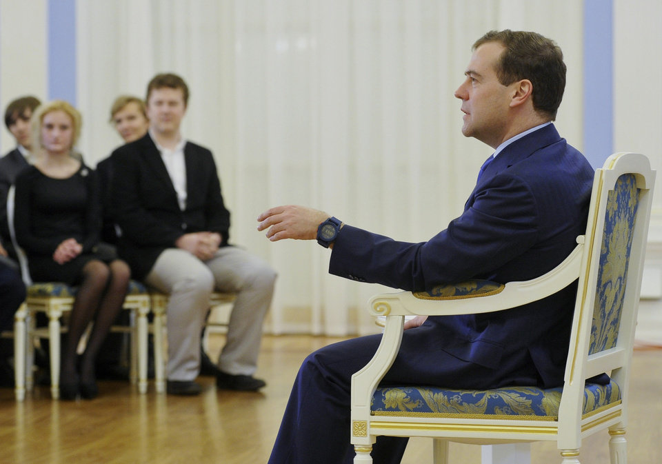 Photo -   Russian Prime Minister Dmitry Medvedev, right, speaks during his meeting with Russian pupils in the Gorki residence outside Moscow, Russia, on Friday, Nov. 2, 2012. Medvedev said Friday that he detested the Pussy Riot act, but added the women have been in prison long enough and should be released. (AP Photo/RIA-Novosti, Alexander Astafyev, Government Press Service)