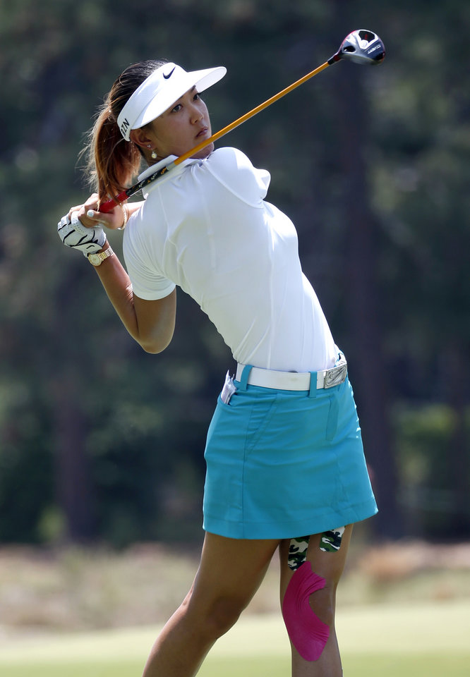 Photo - Michelle Wie watches her tee shot on the second hole during the first round of the U.S. Women's Open golf tournament in Pinehurst, N.C., Thursday, June 19, 2014. (AP Photo/John Bazemore)