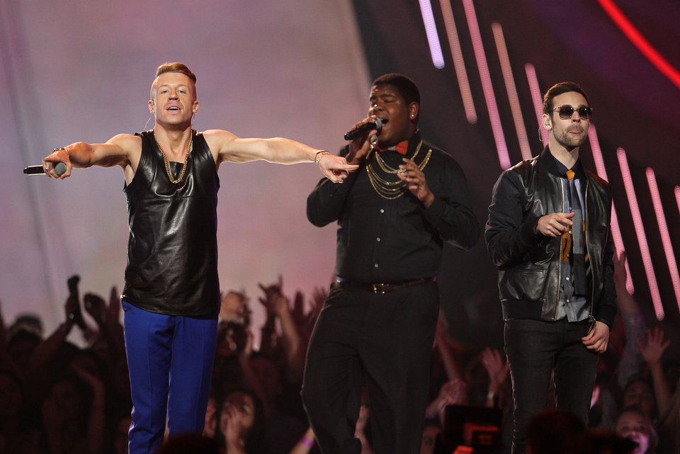FILE - This April 14, 2013 file photo shows Macklemore, left, and Ryan Lewis, right, performing