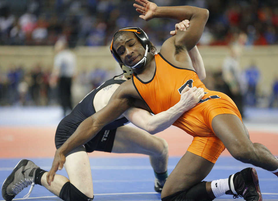 Photo - Putnam City's Keegan Moore wrestles Broken Arrow's Zack Edwards in a semifinal 132 pound match in the Class 6A state wrestling tournament at Jim Norick Arena at State Fair Park in Oklahoma City, Friday, Feb., 28, 2014. Photo by Bryan Terry, The Oklahoman