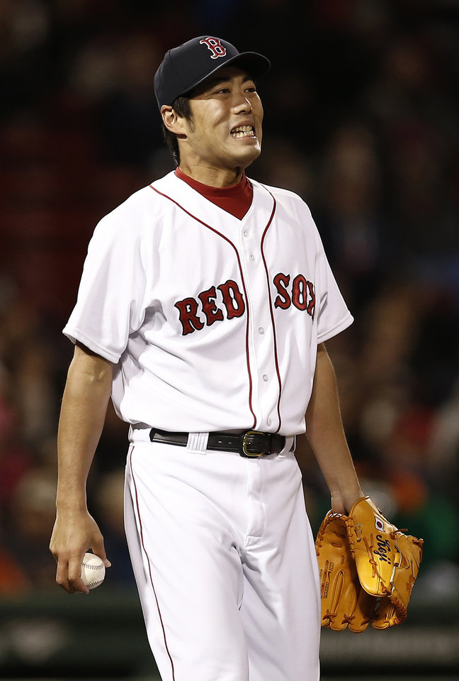 Boston Red Sox relief pitcher Koji Uehara, of Japan, reacts after giving up an RBI-double to Baltimore Orioles' Adam Jones during the seventh inning of a baseball game at Fenway Park in Boston, Thursday, April 11, 2013. (AP Photo/Winslow Townson)