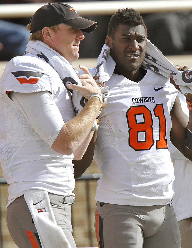 Oklahoma State Cowboys quarterback Brandon Weeden (3) and Justin Blackmon (81) talk  on the sideline during the college football game between the Oklahoma State University Cowboys (OSU) and Texas Tech University Red Raiders (TTU) at Jones AT&T Stadium on Satruday, Nov. 12, 2011. in Lubbock, Texas.  Photo by Chris Landsberger, The Oklahoman  ORG XMIT: KOD