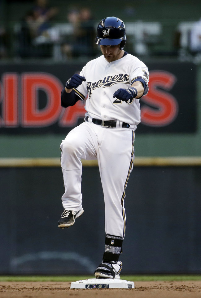 Photo - Milwaukee Brewers' Jonathan Lucroy reacts after hitting an RBI double during the fourth inning of a baseball game against the Minnesota Twins, Monday, June 2, 2014, in Milwaukee. (AP Photo/Morry Gash)