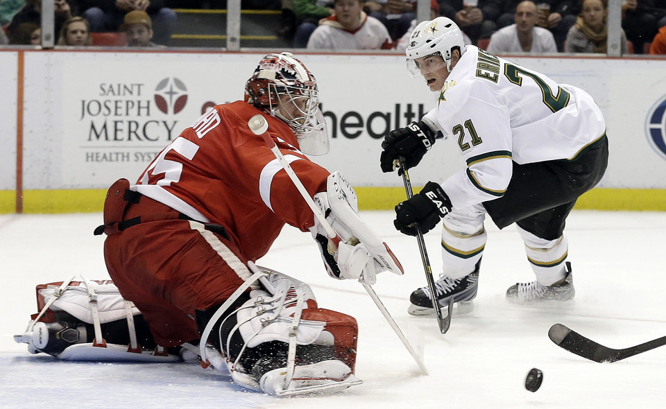 Photo - Detroit Red Wings goalie Jimmy Howard (35) stops a shot by Dallas Stars' Loui Eriksson (21) shot during the first period of an NHL hockey game in Detroit, Tuesday, Jan. 29, 2013. (AP Photo/Paul Sancya)