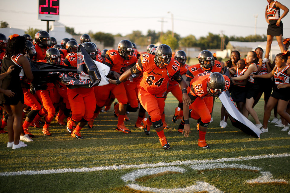 Photo - The Douglass teams takes the field  before a high school football game between Douglass and Booker T. Washington at Douglass in Oklahoma City, Friday, September 6, 2013. Photo by Bryan Terry, The Oklahoman
