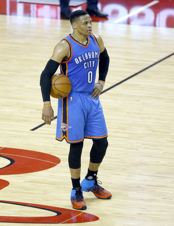 Photo - Oklahoma City's Russell Westbrook (0) holds the ball to end the first quarter during Game 5 in the first round of the NBA playoffs between the Oklahoma City Thunder and the Houston Rockets in Houston, Texas,  Tuesday, April 25, 2017.  Houston won 105-99. Photo by Sarah Phipps, The Oklahoman