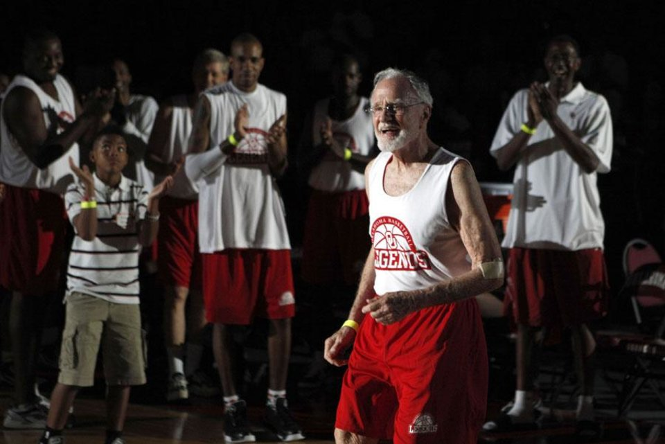 Photo -  Keith Miller, 84, is introduced before the reunion basketball game at the Sooner Basketball Family Weekend at Lloyd Noble Center in Norman, Okla., Saturday, Aug. 27, 2011. Miller was on the OU basketball team from 1948 to 1950. Photo by Sarah Phipps, The Oklahoman