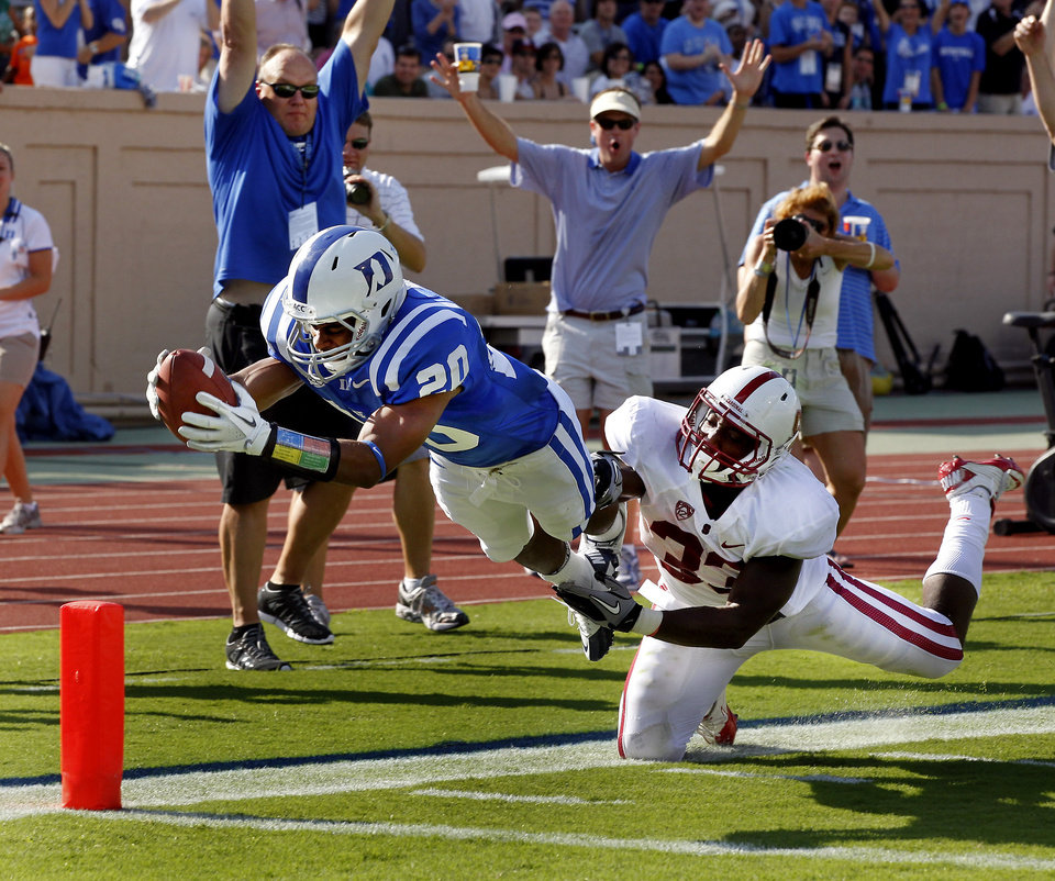 Duke safety Lee Butler (20) dives into the end zone to score after intercepting a second-quarter Stanford pass, as Stanford running back Stepfan Taylor (33) tries to make the stop during an NCAA college football game Saturday, Sept. 10, 2011, in Durham, N.C. (AP Photo/The News & Observer, Chuck Liddy) MANDATORY CREDIT