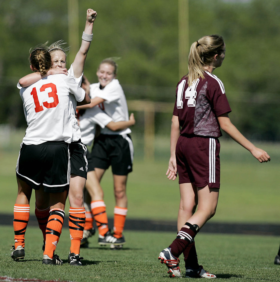 Photo - Norman against Jenks in the Class 5A Girls Soccer Championship at Bixby High School, Saturday, May 14, 2005.    GIRLS HIGH SCHOOL SOCCER STATE TOURNAMENT, CELEBRATION: Drew Biddick, left, and Sandy Brown of Norman celebrate as Ashley Farrand of Jenks walks off the field after Norman won the 5A State Championship. By Bryan Terry/The Oklahoman