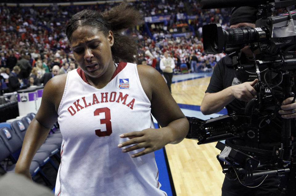Photo - Sooner Courtney Paris leaves the floor as University of Oklahoma is defeated by Louisville 61-59 at the 2009 NCAA women's basketball tournament Final Four in the Scottrade Center in Saint Louis, Missouri on Sunday, April 5, 2009. 