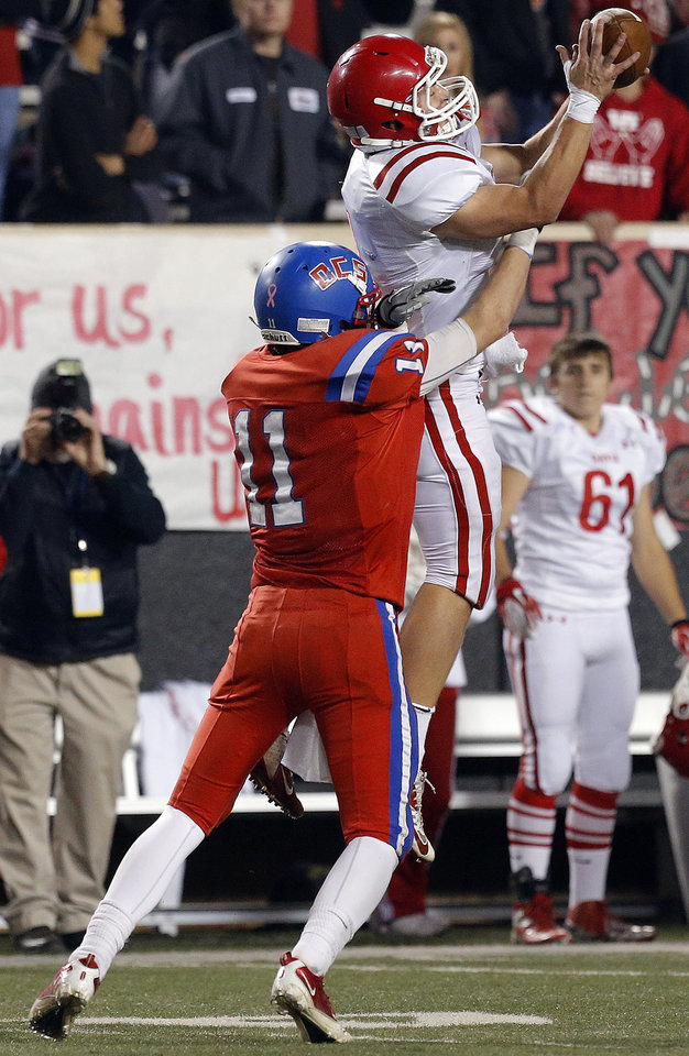 Davis' Alec Hetherington intercepts a pass intended for OCS' Garrett Kilborn during the Class 2A high school football championships between Davis and Oklahoma Christian School at Boone Pickens Stadium in Stillwater, Okla.,  Saturday,Dec. 8, 2012. Photo by Sarah Phipps, The Oklahoman