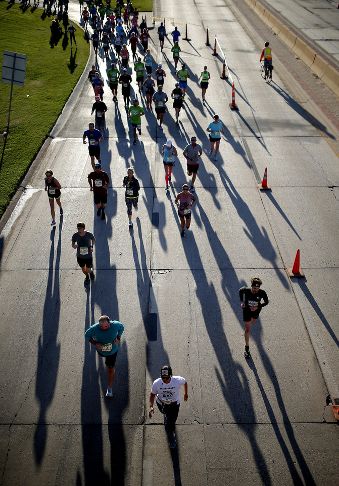 Photo - Runners run on NE 23rd near the State capitol during Oklahoma City Memorial Marathon in Oklahoma City, Sunday, April 28, 2019. [Sarah Phipps/The Oklahoman]