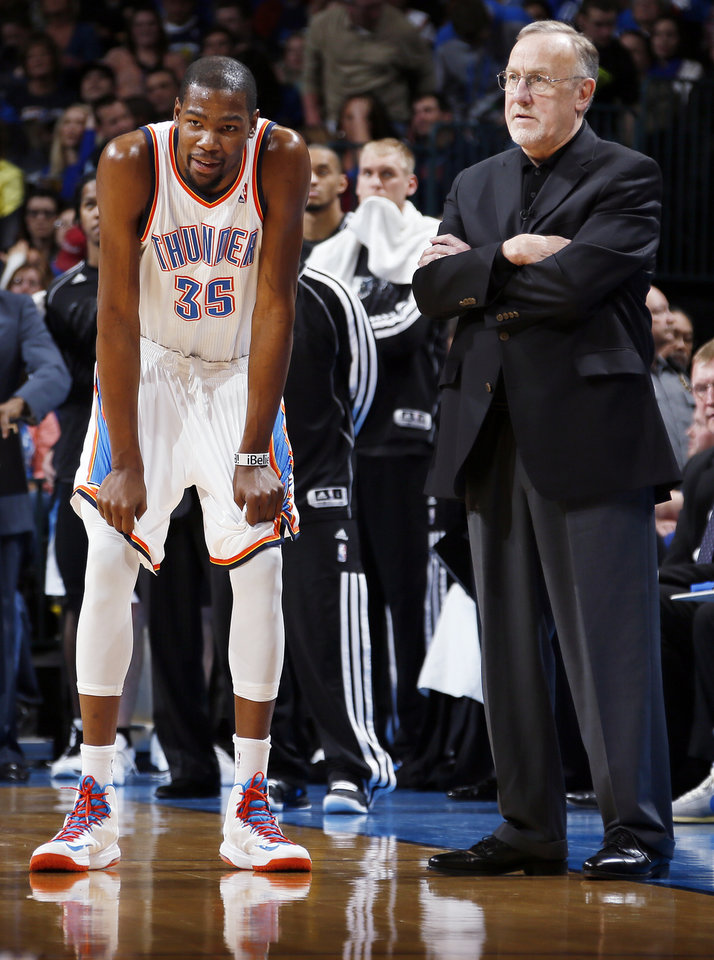Photo - Oklahoma City's Kevin Durant (35) talks with Minnesota coach Rick Adelman during an NBA basketball game between the Oklahoma City Thunder and Minnesota Timberwolves at Chesapeake Energy Arena in Oklahoma City, Friday, Feb. 22, 2013. Photo by Nate Billings, The Oklahoman