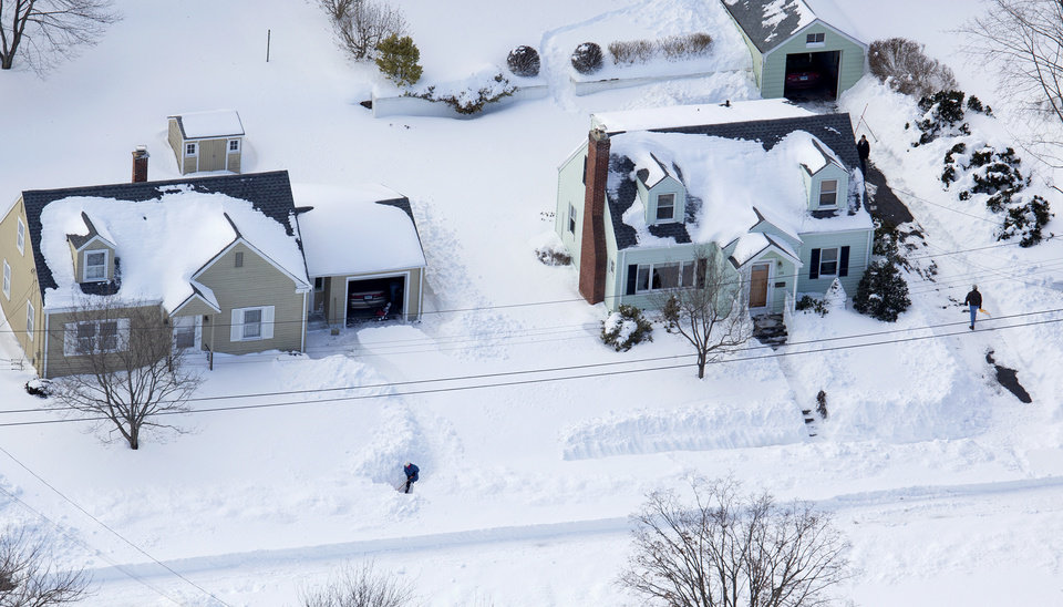 Photo - People dig out from an historic snowfall Sunday, Feb. 10, 2013, near Hamden, Conn., in the aftermath of a storm that hit Connecticut and much of the New England states. (AP Photo/Craig Ruttle)