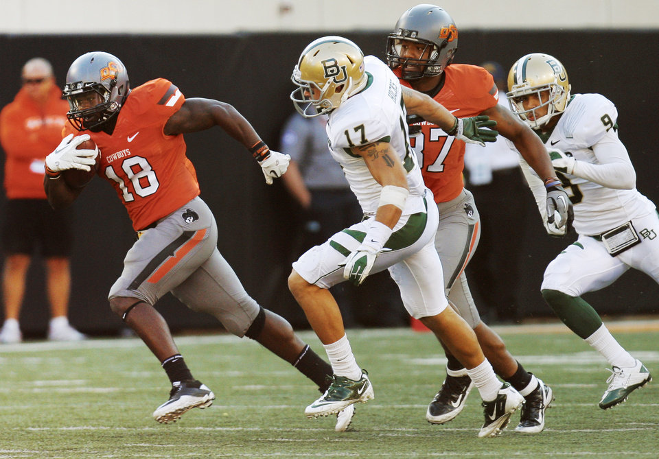 Photo - OSU's Herschel Sims (18) leaves behind Baylor's Mike Hicks (17) and Chance Casey (9) as well as OSU's Tracy Moore (87) on a touchdown run in the fourth quarter during a college football game between the Oklahoma State University Cowboys (OSU) and the Baylor University Bears (BU) at Boone Pickens Stadium in Stillwater, Okla., Saturday, Oct. 29, 2011. OSU won, 59-24. Photo by Nate Billings, The Oklahoman