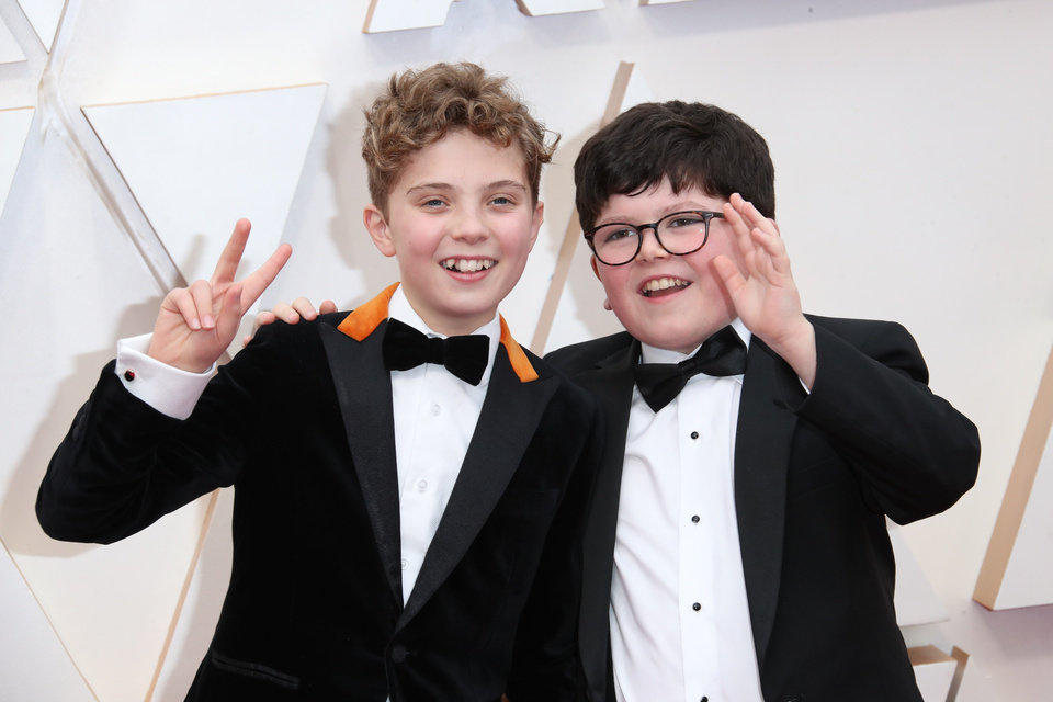 Photo - Feb 9, 2020; Los Angeles, CA, USA;   Roman Griffin Davis, left and Archie Yates arrive at the 92nd Academy Awards at Dolby Theatre. Mandatory Credit: Dan MacMedan-USA TODAY
