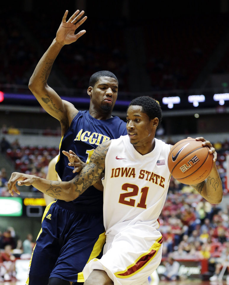 Photo -   Iowa State guard Will Clyburn (21) drives past North Carolina A&T forward Adrian Powell during the first half of an NCAA college basketball game, Tuesday, Nov. 20, 2012, in Ames, Iowa. (AP Photo/Charlie Neibergall)