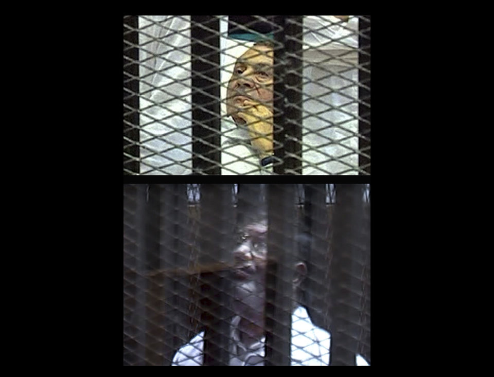 Photo - COMBO - This combination of two pictures made from video broadcast on Egyptian state television show, from top: Egypt's ousted President Hosni Mubarak inside the defendant's cage inside a Cairo courtroom during his trial Wednesday, Aug. 3, 2011 on charges of corruption and ordering the killing of protesters during the uprising that ousted him; and ousted President Mohammed Morsi inside the defendant's cage in a Cairo courtroom on Tuesday, Jan. 28, 2014 during his trial on charges of over charges related to the prison breaks at the height of the 18-day 2011 uprising against his predecessor Hosni Mubarak. (AP Photo/Egyptian state TV via AP video)