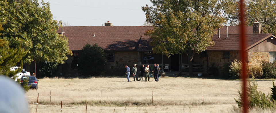 Police and investigators standing in front  of a house in the 11000 block of S Bryant in Oklahoma City Wednesday, Nov 14, 2012. Photo by Paul B. Southerland, The Oklahoman