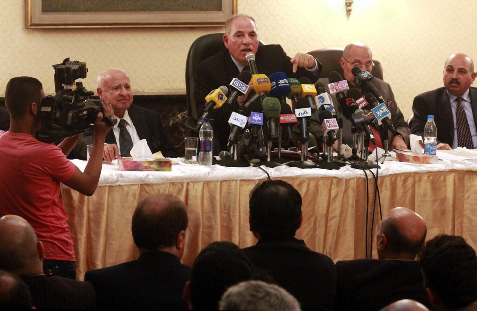 Photo - In this Sunday, Dec. 2, 2012 photo, the head of the powerful Egypt Judges Club Ahmed el-Zind, center, speaks at a press conference announcing that judges will not oversee the Dec. 15, 2012 referendum to approve a contentious draft constitution in Cairo, Egypt. El-Zind's comments are the latest in a standoff between President Mohammed Morsi and the judiciary with most judges on strike following decrees Morsi issued last month that placed himself and the constitutional assembly above judicial oversight. (AP Photo/Ahmed Ramadan)