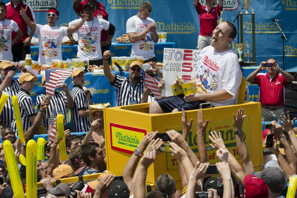 Joey Chestnut, now seven-time winner of the Nathan�s Famous Fourth of July International Hot Dog Eating contest, is carried to the competition stage.