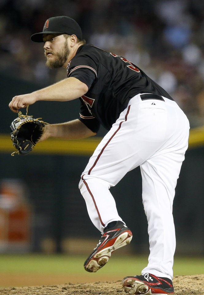Photo - Arizona Diamondbacks' Wade Miley follows through on a pitch to the Atlanta Braves during the fifth inning of a baseball game Saturday, June 7, 2014, in Phoenix. (AP Photo/Ross D. Franklin)