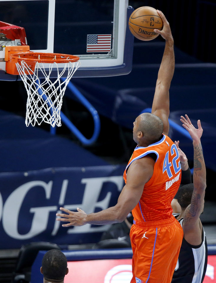Photo - Oklahoma City's Al Horford (42) dunks the ball during an NBA basketball game between the Oklahoma City Thunder and the San Antonio Spurs at Chesapeake Energy Arena in Oklahoma City, Tuesday, Jan. 12, 2021. [Bryan Terry/The Oklahoman]