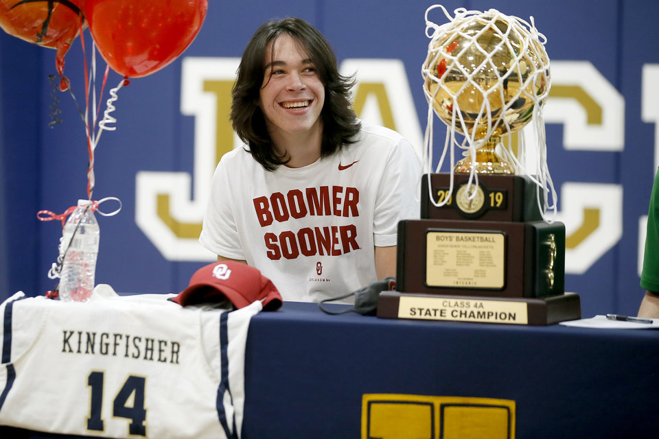 Photo - Kingfisher basketball player Bijan Cortes smiles during a signing day ceremony at Kingfisher High School, Wednesday, Nov. 11, 2020. [Bryan Terry/The Oklahoman]