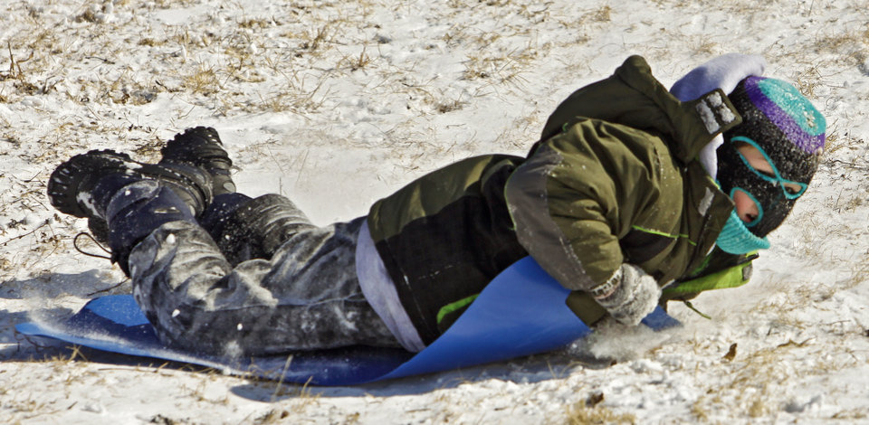 Photo - Jerrett Derrick, 7, gets sideways as he slides down the hill while sledding at Will Rogers Park on Wednesday, Feb. 2, 2011, Oklahoma City, Okla.   Photo by Chris Landsberger, The Oklahoman