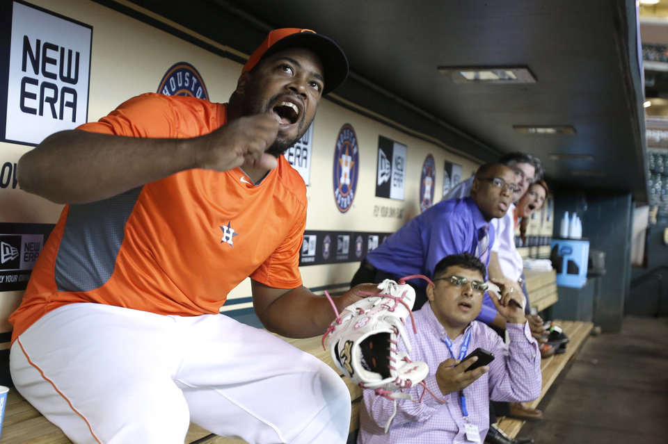 Houston Astros relief pitcher Jerome Williams, left, cheers as he and reporters watch the World Cup soccer match between the United States and Germany before the baseball game between the Astros and the Atlanta Braves Thursday, June 26, 2014, in Houston. (AP Photo/Pat Sullivan)
