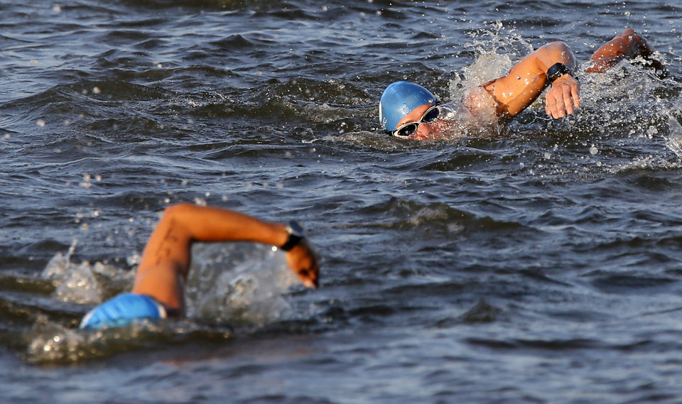 Photo -  Competitors swim during the Arcadia Lake Triathlon and Aquabike at Edmond Park on Arcadia Lake in Edmond. PHOTO BY NATE BILLINGS, THE OKLAHOMAN   NATE BILLINGS - NATE BILLINGS