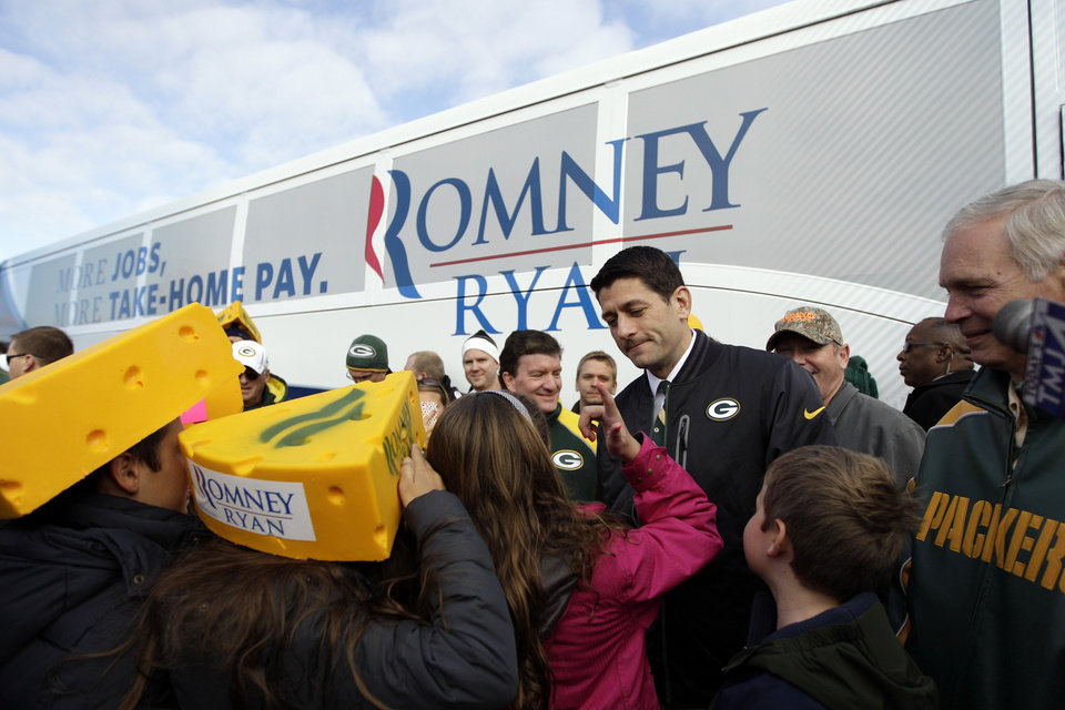 Photo -   Republican vice presidential candidate, Rep. Paul Ryan, R-Wis., talks to his daughter Liza at a tailgate party for the football game between the Green Bay Packers and the Arizona Cardinals at Lambeau Field, Sunday, Nov. 4, 2012 in Green Bay , Wis. (AP Photo/Mary Altaffer)