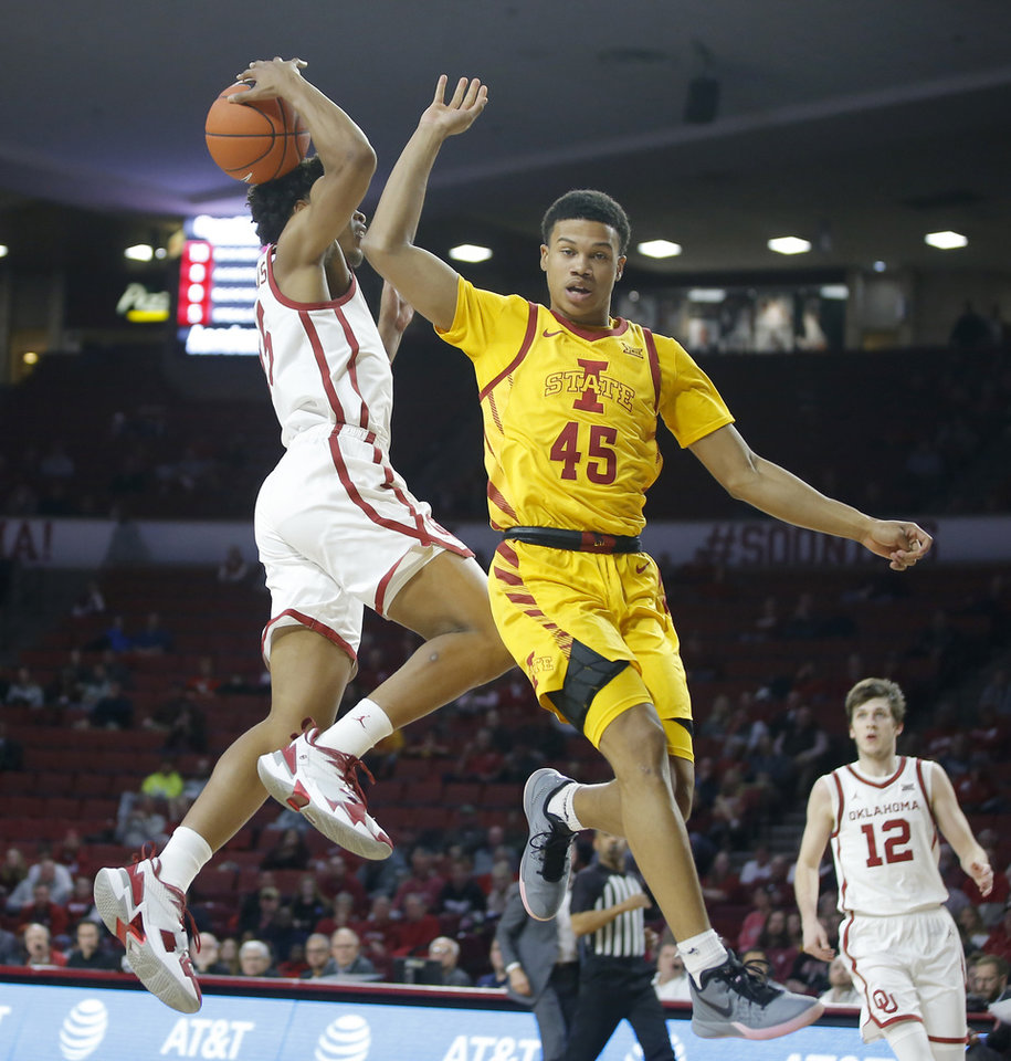 Photo - Oklahoma's Alondes Williams (15) goes to the basket and scores beside Iowa State's Rasir Bolton (45) during an NCAA basketball game between the University of Oklahoma Sooners (OU) and the Iowa State Cyclones at the Lloyd Noble Center in Norman, Okla., Wednesday, Feb. 12, 2020. [Bryan Terry/The Oklahoman]