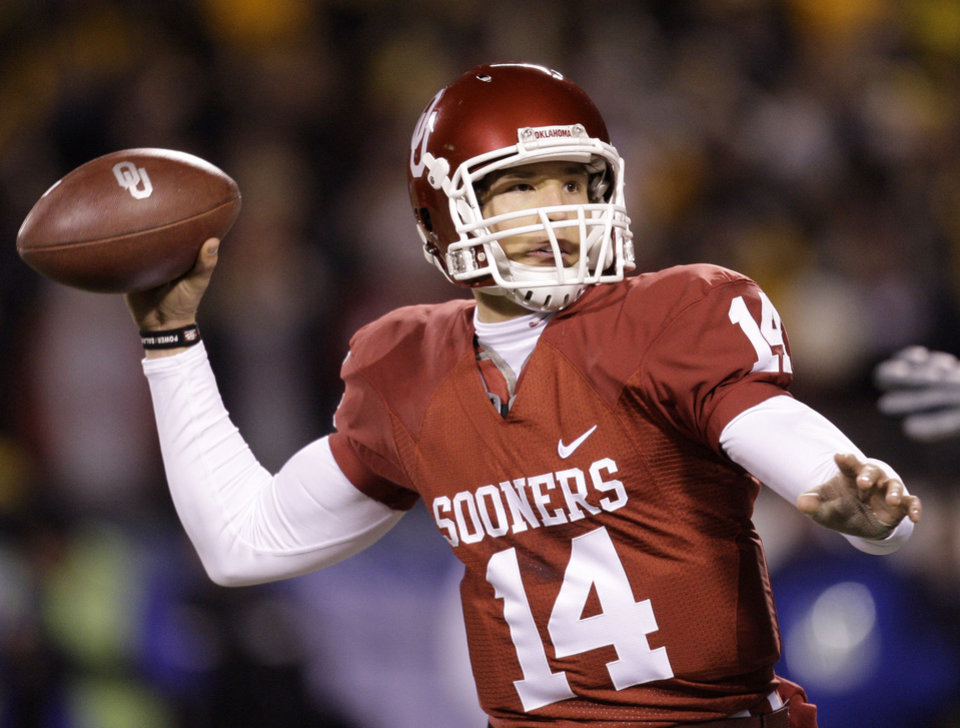 Photo - University of Oklahoma quarterback Sam Bradford drops back to pass during the first quarter of the Big 12 Championship college football game against University of Missouri Saturday, Dec. 6, 2008 in Kansas City, Mo. (AP Photo/Charlie Riedel) ORG XMIT: MOCR102