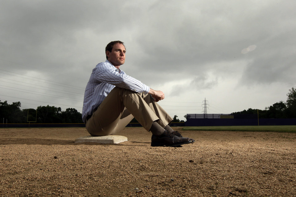 Photo - In this Thursday, May 23, 2013 photo, Garrett Broshuis poses for a photo at a baseball field in St. Louis. Broshuis, a former minor leaguer for the San Francisco Giants, has talked about the cheating he observed during his time playing professionally, even going so far as to say one of his coaches suggested he try it. (AP Photo/Jeff Roberson)