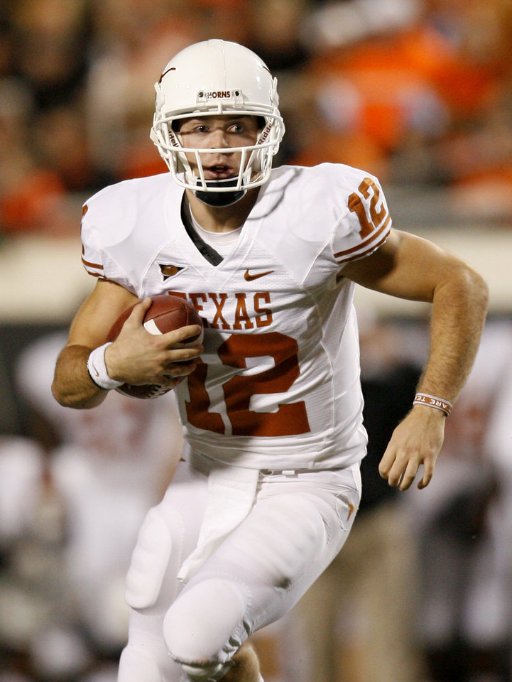 Photo - Texas quarterback Colt McCoy (12) scrambles during the college football game between the Oklahoma State University Cowboys (OSU) and the University of Texas Longhorns (UT) at Boone Pickens Stadium in Stillwater, Okla., Saturday, Oct. 31, 2009. Photo by Sarah Phipps, The Oklahoman