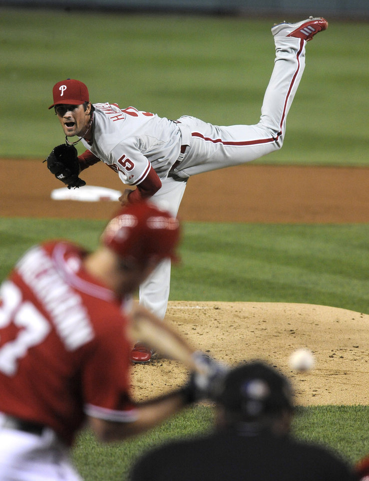 Photo -   Philadelphia Phillies' starting pitcher Cole Hamels delivers pitch to Washington Nationals' batter Jordan Zimmermann during second inning of their baseball game at Nationals Park, Sunday, May 6, 2012, in Washington. (AP Photo/Richard Lipski)