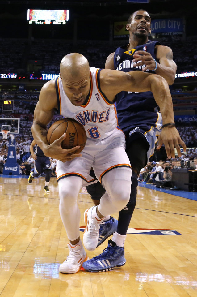 Oklahoma City's Derek Fisher grabs the ball in front of Memphis' Mike Conley during Game 5 in the second round of the NBA playoffs between the Oklahoma City Thunder and the Memphis Grizzlies at Chesapeake Energy Arena In Oklahoma City, Wednesday, May 15, 2013. Photo by Bryan Terry, The Oklahoman